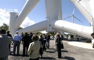 People under a wind turbine
